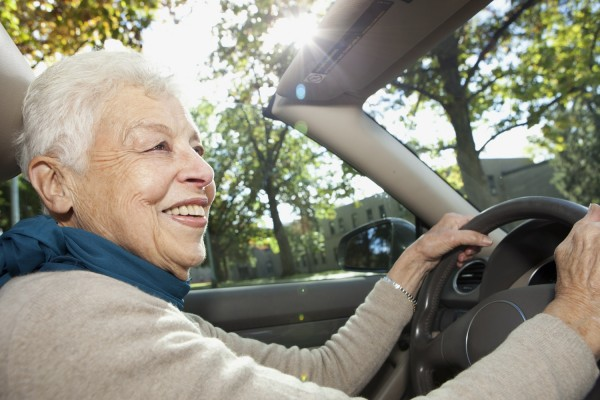 Image: An elderly woman drives a car